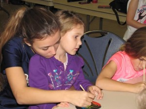 Claire Cardillo and 1st grader work on crafts together