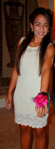 Alexis Ercia wears a beautiful white, lace dress.