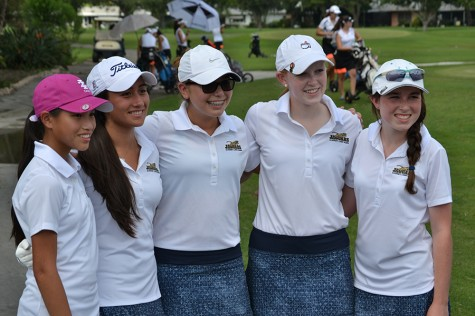Shown are a few members of the golf team posing after a successful golf tournament.