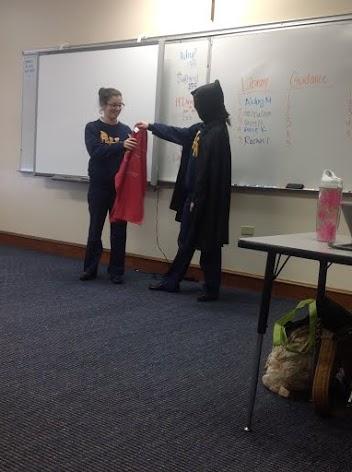 The Grimm Reaper hands Sophomore, Bella Guerra, the shirt that represents death.