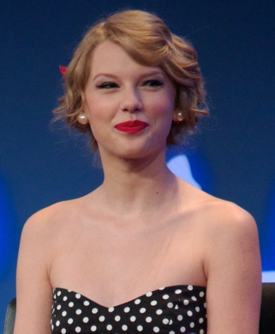 """After watching the success of the record breaking 1989, I believe Taylor Swift's hit """"Shake it Off"""" will take the award for Song of the Year."""