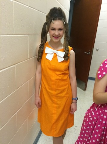 Lizzie's orange dress and white bow made her a mirror image of Penny!