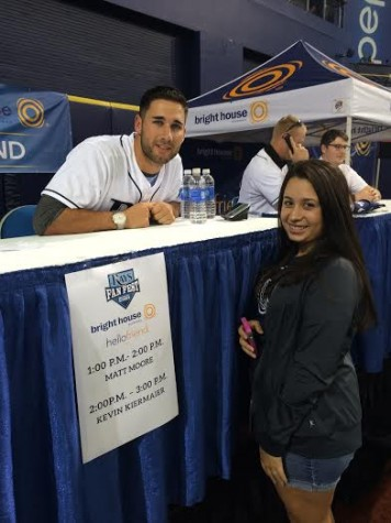 Senior Tiffany Reyes posing with Kevin Kiermaier at Rays Fan Fest,