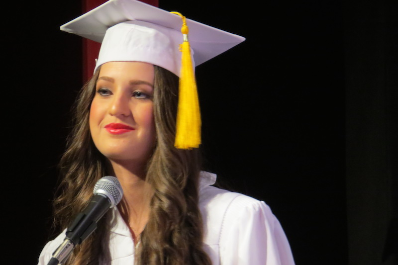 Maddy Babin gives one last smirk to end her Valedictorian speech.