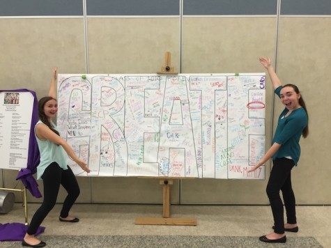 Sophomore's Leila Zupsic and Kathryn Byers pose next to the CREATE sign.