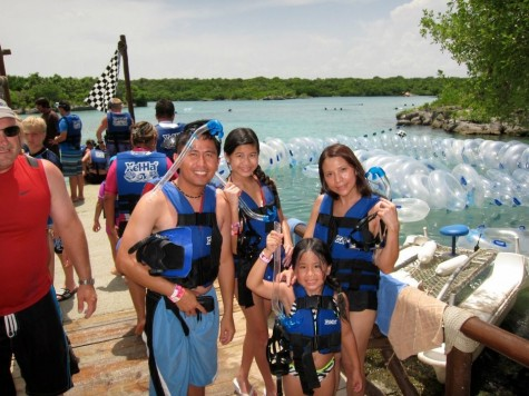 Marie Dela Cruz and her family try snorkeling in Cancun
