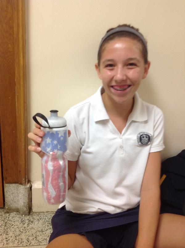 Emma shows how happy she is with her patriotic polar bottle.