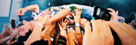 lead singer of Grouplove getting up close and personal with the crowd photo creds: Reilly Sleater
