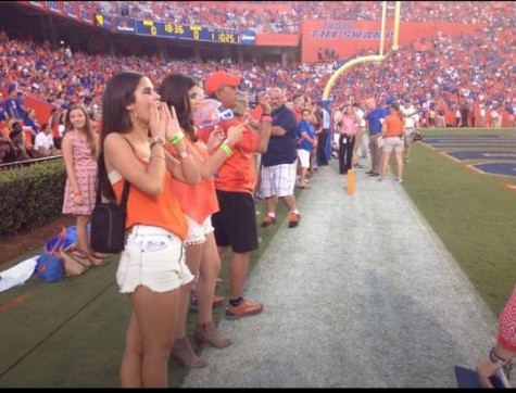 Senior Isabella Alfonso cheering on the Gators last season from the end zone.