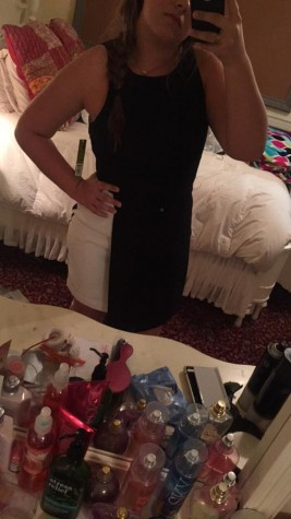 Senior Jackie Joyce taking a selfie in her 2015 homecoming dress