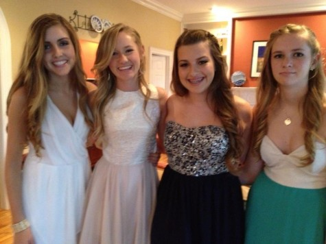 Senior Jackie Joyce, third from the left, wearing a strapless sparkle dress freshman year