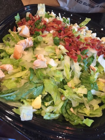 The Grilled Chicken Salad is always a great and delicious option to order at PDQ, topped with bacon pieces.