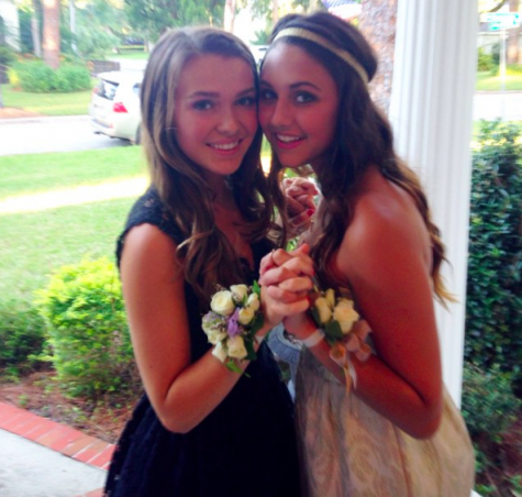 Sarah Conn (10) and Alexandra Traviesa (10) take some pictures before heading off to group Homecoming pictures