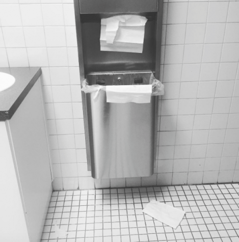 Paper Towels cause mess on ground and around trash bin.