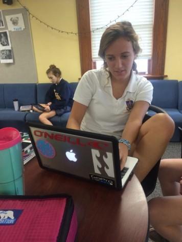 Senior, Hadley Chillura, working on her Economics homework in the lounge