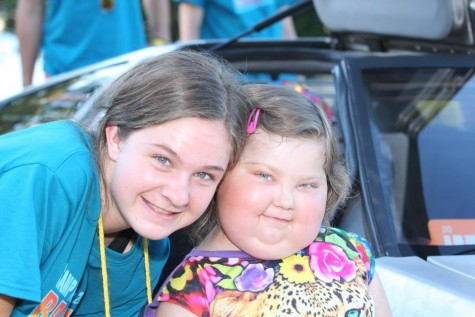 Lizzie and her camper, Liza, pose for a picture at camp in Seattle!
