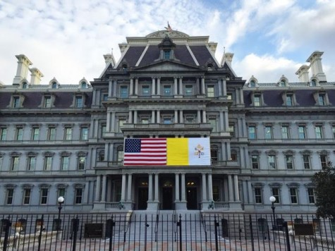 The Eisenhower Executive Office Building on the White House Complex displays both the US and Vatican flags in preparation for the Pope's visit.