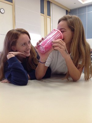 Sophomores Nina Alberdi and Sara Phillips, both athletes, believe drinking water is essential to the success in their sport.