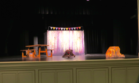 The set was decorated with props in order to resemble a camp-site.