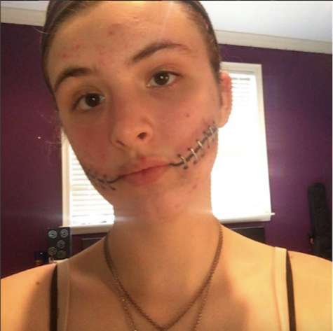 "Traud shares, ""For this stitched smile effect, all I used was eyeliner and eyeshadow."" Credit: Olivia Traud"