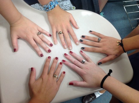 Grayson Garraty, Natalie Cevallos, Lindsay Boos, Veronica Sanchez and Taylor Shaw display their freshly manicured nails from Homecoming.