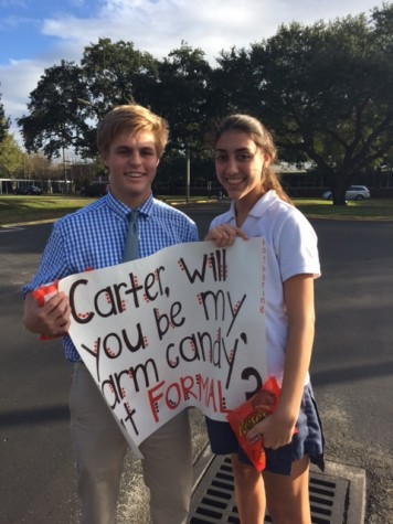 Sophomore Katherine Hahn asking her friend Carter Anderson to Christmas Formal with his favorite treats.