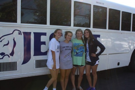 AHN swim girls stop for a quick picture before the long ride to Stuart, FL. Credit: Gabby Delp