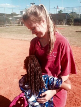 Photo Credits: Twitter/AHN TLC Christina Thompson and her buddy hug at the end of a fun game!