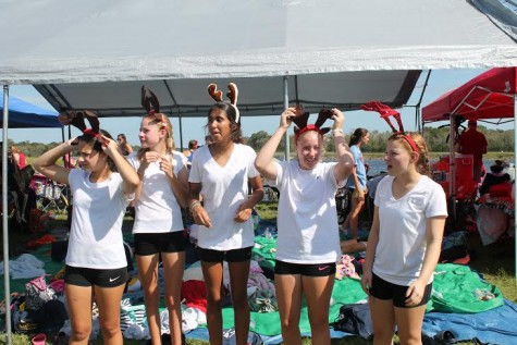 Freshman look for santa (their coxswain Teresa) in the crowd of rowers.