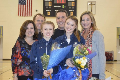 Bajo and Thompson were supported by both their parents on their special Senior Night