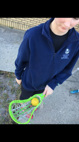 Each girl has their own lacrosse stick with their own individual nets and tape. Alexa Traviesa has a neon green stick with white and green net.