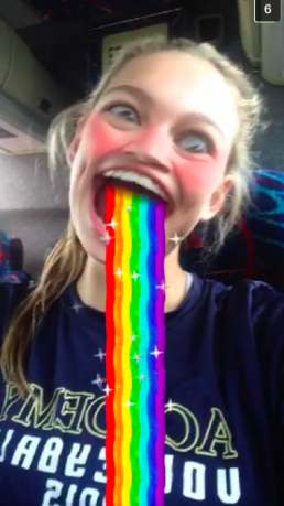 Junior, Camille Opp, shows off her goofy side by using the rainbow facial feature that snapchat offers!