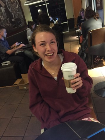 Credit: Rachel McKenna/Achona Online Abby Morris smiles with her Molten Hot Chocolate even though she believes it lacks a few ingredients, like more sugar.