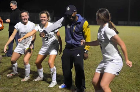 "Lester, Boos, and junior Hannah Menendez teach coach, Kareem Escayg, DLOW's ""Bet You Can't Do It Like Me"" after winning districts."