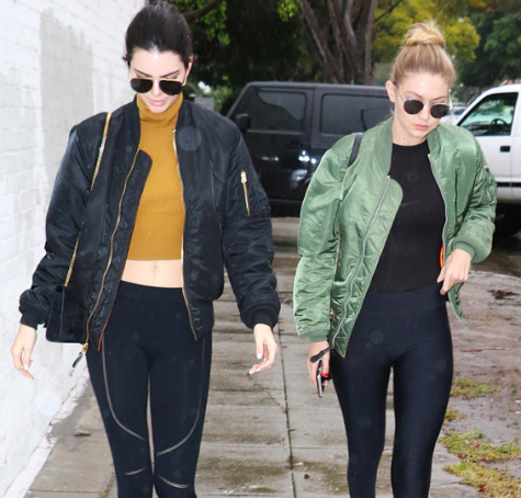 Kendal and Gigi looking flawless as always in their bomber jackets and leggings, two staple pieces within the world of athleisure wear.