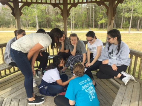"""Students working in their small groups on word puzzles. Christina Thompson states, """"My group worked well together. It was good to know that no matter who we get paired with, we always get along and have a good time."""""""
