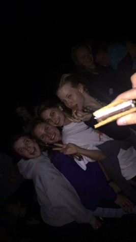 Making s'mores with all 99 sisters.