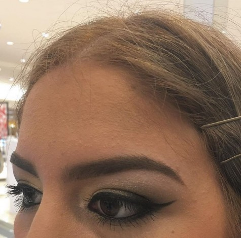 Alejandra Lozano, winged eyeliner done by the Mac makeup counter.