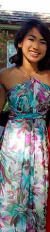 Clarisse is rocking a multicolored patterned dress.