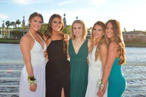 From left to right seniors Megan Bajo, Lily Oliva, Christina Thompson, Carolina Oliva and Gabby Accardi pose for a photo at Jesuit prom. Clearly their dates prioritized photo location, as Curtis Hixon Park is a popular and scenic location to snap some pictures before the dance.
