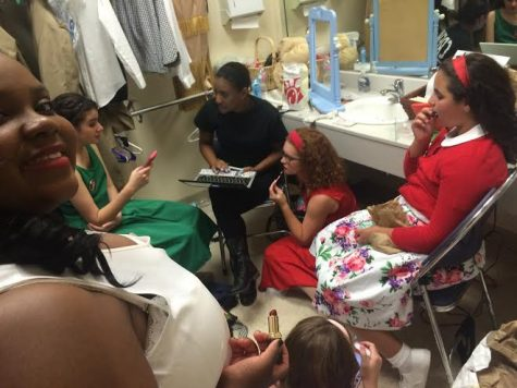 Credit: Avery Dierks Cast members waiting backstage in a room trying to stay out of the way of al the commotion.