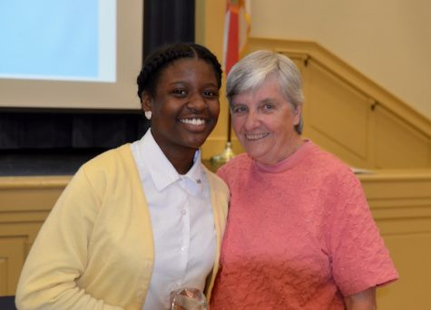 Chant Belcher poses with Sister Ann Regan after winning the Freshman of the Year Award to end her Freshman year.