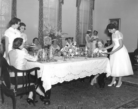 (Photo Credit: AHN Archives/ Used With Permission)  In 1979 when this photo was taken, Silver Coffee still clung to it's tradition as a welcome back celebration for alumni mothers. Their daughters would have formally waited on them with silver teapots that are still used today.