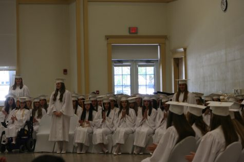 Each honors society announces their members and has them stand to be recognized during the ceremony.