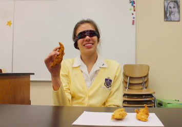 """(Photo Credit: Keri Kelly/Achona Online) As junior Lindsay Calka fiddles with the chicken strip in her hand, she ponders, """"I'm going to just guess from the feeling that it's PDQ."""" And she was right!"""