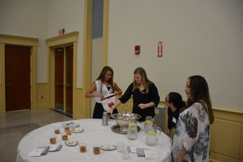 (Photo Credit: Lindsay Calka/Used With Permission) Junior Ambassadors Gabbie Ragano (left) and Laura Henry help make the punch for the coffee.