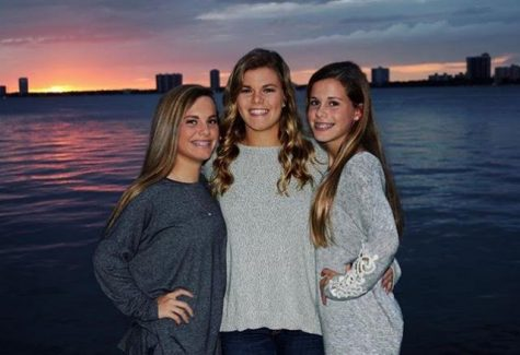 Senior Lindsay Boos with her little sisters Ellie and Audrey Credit: Lindsay Boos