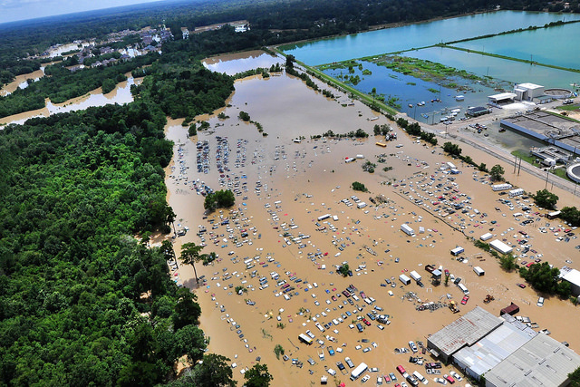 A view from an MH-65 Dolphin helicopter shows flooding and devastation in Baton Rouge, Louisiana, 15 August 2016, where service members have rescued residents and provided relief. Credit: Courtesy of United States Coast Guard/Melissa Leake/Flikr