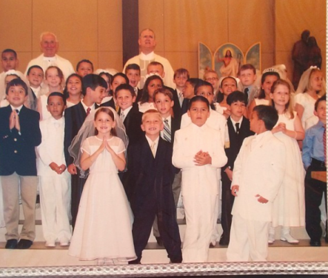 Isabella Bahr (far right) at her First Holy Communion at St. Lawrence with Monsignor Higgins (far left). Bahr spent ten years at STL.
