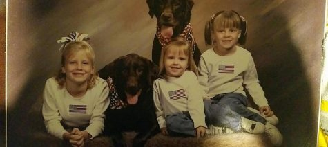 Covered in American flag apparel, Wiley (pictured in the middle) shows her patriotism at a young age. Photo Credit: Humane Society (used with permission)